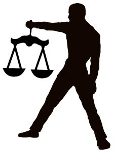 Man with scales of justice